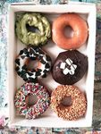 $8 for Half a Dozen Doughnuts with Purchase of 1 Dozen Doughnuts at Krispy Kreme